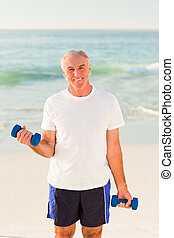 Senior man doing his exercises