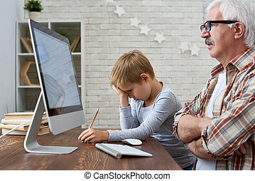 Senior Man Doing Homework with Grandson