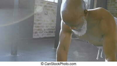 Senior man doing push ups with dumbbells 4k