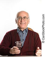 senior man drinking beer