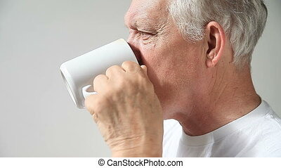 senior man drinking coffee