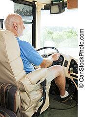 Senior Man Drives Motor Home