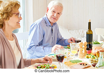 Senior Man Enjoying  Family Dinner