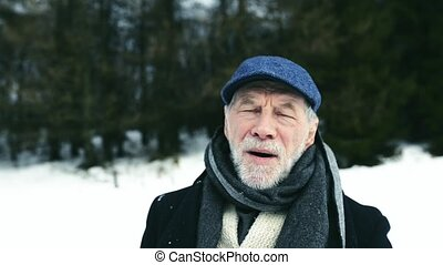 Senior man enjoying himself on a winter day.