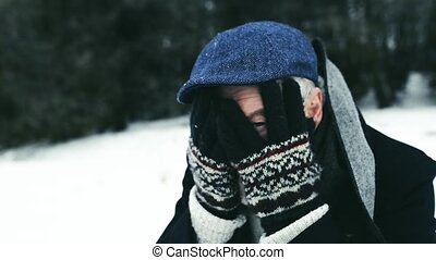 Senior man enjoying himself on a winter day. - Senior man...