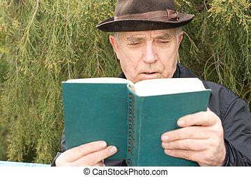 Senior man enjoying his novel