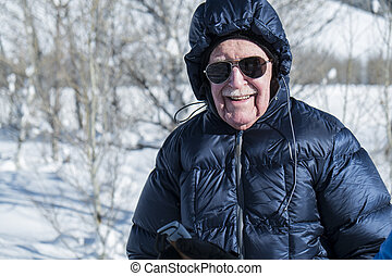 Senior man enjoying winter