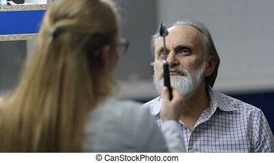 Senior man examined by female neurologist in clinic - Senior...