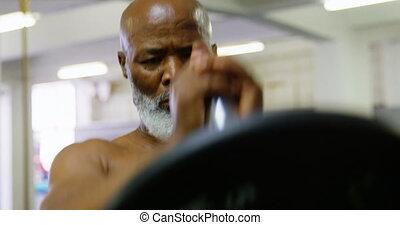 Senior man exercising with barbell weight 4k - Senior man ...