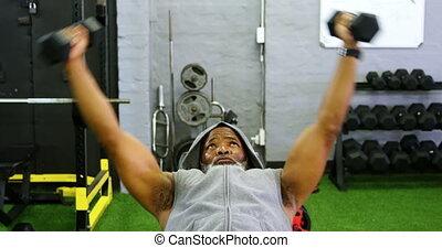 Senior man exercising with dumbbell 4k - Senior man ...