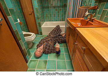 Senior man falling - A senior man fell on a bathroom floor ...