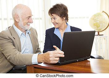 Senior Man Financial Advice - Mature businesswoman giving...
