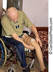 Senior man fitting a prosthetic leg