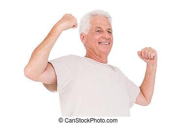 Senior man flexing his arms