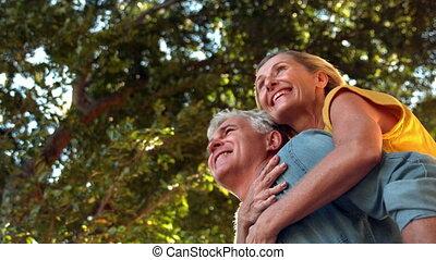 Senior man giving his partner