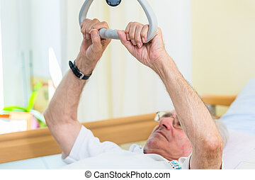 Senior man grabbing handle to get out of bed