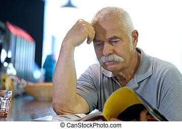senior man hangout in a bar
