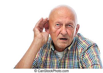 Senior man cupping his ear having difficulty hearing