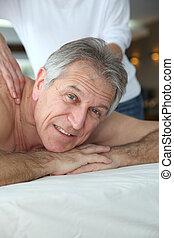 Senior man having a massage