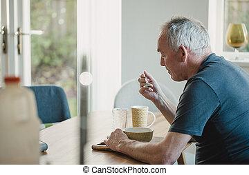 Senior Man Having Breakfast