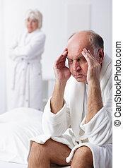 Senior man having headache