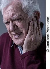 Senior man having toothache - Portrait of senior man having ...