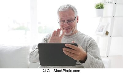 senior man having video call on tablet pc at home 10