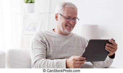 senior man having video call on tablet pc at home 118