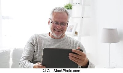 senior man having video call on tablet pc at home 12