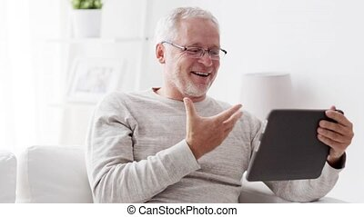 senior man having video call on tablet pc at home 89
