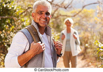 senior man hiking with wife