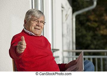 Senior man holding thumbs up