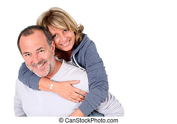 Senior man holding wife on his back