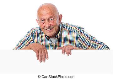 Senior man holds a blank board