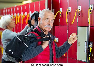 senior man in a gym locker-room