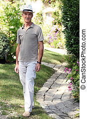 Senior man in a summer garden