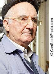 Senior man in cap and eyeglasses