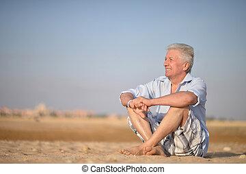 Senior man in desert
