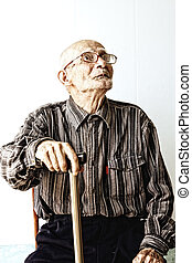 Senior man in eyeglasses looking up