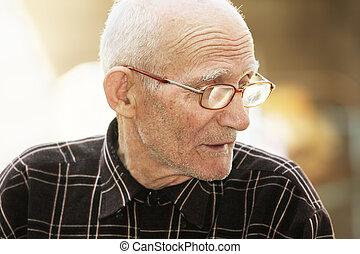Senior man in eyeglasses outdoor portrait