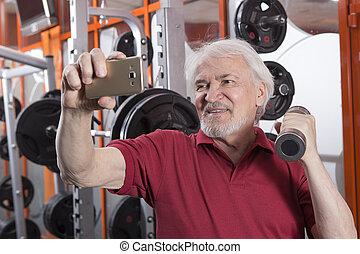 Senior man in fitness center