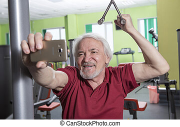 Senior man in fitness center