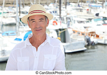 Senior man in front of port