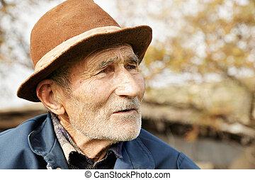 Senior man in hat