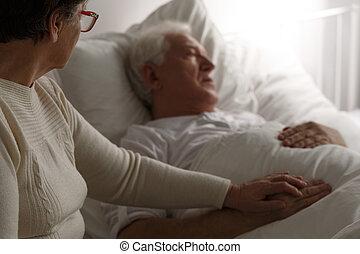 Senior man in hospital bed - Sad senior man in hospital bed...