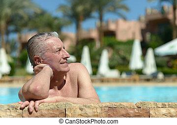 Senior man in pool