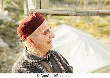 Senior man in red cap