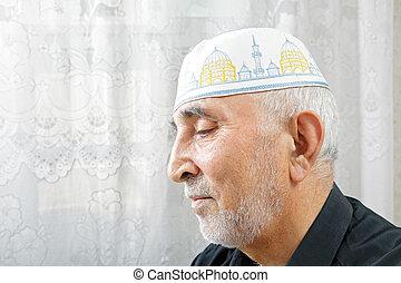 Senior man in religious hat