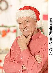 Senior man in santa hat