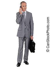 Senior man in suit on white background